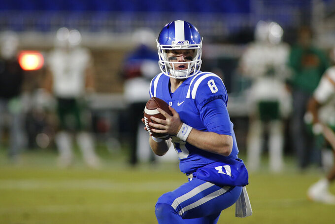 Duke quarterback Chase Brice (8) runs the offense against Miami during the second half of an NCAA college football game Saturday, Dec. 5, 2020, in Durham, N.C. (Nell Redmond/Pool Photo via AP)