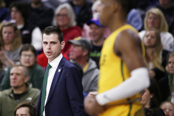 San Francisco coach Todd Golden, left, speaks with guard Jamaree Bouyea during the second half of the team's NCAA college basketball game against Gonzaga in Spokane, Wash., Thursday, Feb. 20, 2020. Gonzaga won 71-54. (AP Photo/Young Kwak)