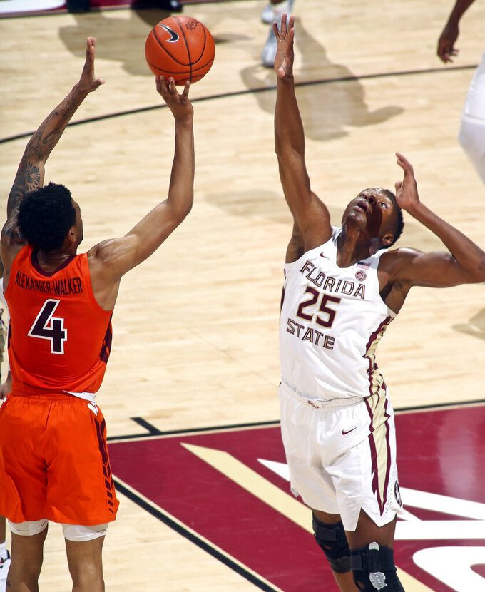 Virginia Tech guard Nickeil Alexander-Walker (4) shoots over Florida State forward Mfiondu Kabengele (25) in the first half of an NCAA college basketball game in Tallahassee, Fla., Tuesday, March 5, 2019. (AP Photo/Phil Sears)