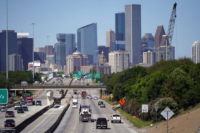 In this Thursday, April 30, 2020, photo traffic moves along Interstate 10 near downtown Houston. Like in other cities, the coronavirus has shut down much of Houston's economic activity, slashing thousands of jobs, while at the same time, the price of oil plunged below zero recently as demand plummeted due to the worldwide lockdown to stop the spread of the virus. This one-two punch from COVID-19 and the collapse in oil prices will make it much harder for Houston to recover from a looming recession, according to economists. (AP Photo/David J. Phillip)