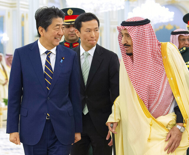 In this photo released by the Saudi Royal Palace, Saudi King Salman, right, receives Japan's Prime Minister Shinzo Abe, in Riyadh, Saudi Arabia, Sunday, Jan. 12, 2020. (Bandar Aljaloud/Saudi Royal Palace via AP)