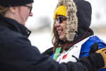In this Feb. 5, 2020 photo Myrinda Hamilton smiles atop the awards podium following her 100-meter snowshoe race during the Special Olympics Wyoming Winter Games in Jackson, Wyo. (Ryan Dorgan/Jackson Hole News & Guide via AP)
