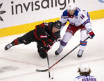 Carolina Hurricanes right wing Andrei Svechnikov (37) and New York Rangers center Ryan Strome (16) battle for the puck during the first period in the NHL hockey Stanley Cup playoffs in Toronto, Saturday, Aug. 1, 2020. (Frank Gunn/The Canadian Press via AP)