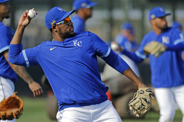 Kansas City Royals' Maikel Franco throws during spring training baseball practice Wednesday, Feb. 19, 2020, in Surprise, Ariz. (AP Photo/Charlie Riedel)