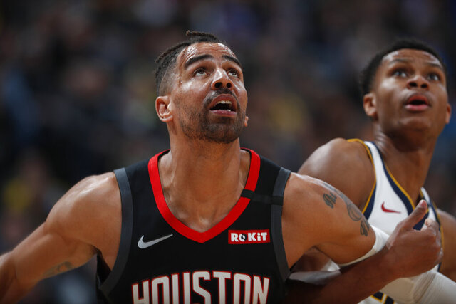 FILE - In a Sunday, Jan. 26, 2020 file photo, Houston Rockets forward Thabo Sefolosha (18), left, and Denver Nuggets guard PJ Dozier (35) in the second half of an NBA basketball game, in Denver. Time has not healed all wounds for Sefolosha, the NBA veteran who says he was attacked by a group of New York Police Department officers in April 2015 while they were arresting him outside a nightclub in the city's Chelsea neighborhood.  (AP Photo/David Zalubowski, File)