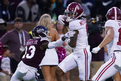 Alabama wide receiver John Metchie III (8) fights off a tackle attempt by Mississippi State cornerback Emmanuel Forbes (13) on his way to a 46-yard touchdown pass reception during the first half of an NCAA college football game in Starkville, Miss., Saturday, Oct. 16, 2021. (AP Photo/Rogelio V. Solis)