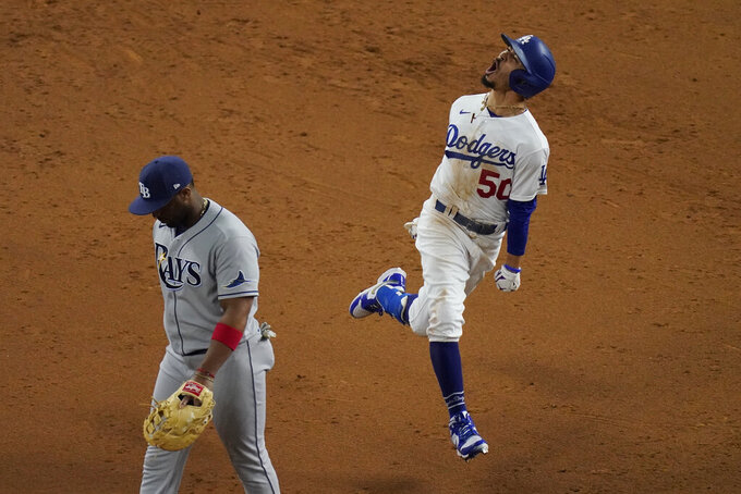 Los Angeles Dodgers' Mookie Betts celebrates after a home run against the Tampa Bay Rays during the eighth inning in Game 6 of the baseball World Series in Arlington, Texas, on Oct. 27, 2020. (AP Photo/Sue Ogrocki)