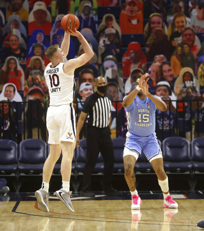 Virginia forward Sam Hauser (10) shoots over North Carolina forward Garrison Brooks (15) during an NCAA college basketball game Saturday, Feb. 13, 2021, in Charlottesville, Va. (Andrew Shurtleff/The Daily Progress via AP, Pool)