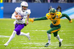 James Madison quarterback Ben DiNucci (6) runs with the ball as North Dakota State cornerback Marquise Bridges (9) pursues during the first half of the FCS championship NCAA college football game, Saturday, Jan. 11, 2020, in Frisco, Texas. (AP Photo/Sam Hodde)