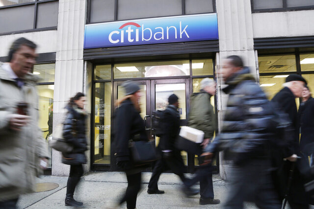 FILE - In this Jan. 15, 2015, file photo, people walk past a branch office of Citibank, in New York. The very thing that makes personal loans appealing — that they can be used to pay for almost anything — is also what makes them difficult to navigate. It's always best to consider all your options, but financial planners say some uses for a loan — like debt consolidation — are better than others.  (AP Photo/Mark Lennihan, File)