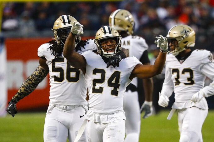 New Orleans Saints strong safety Vonn Bell (24) celebrates a sack with outside linebacker Demario Davis (56) during the second half of an NFL football game against the Chicago Bears in Chicago, Sunday, Oct. 20, 2019. (AP Photo/Charles Rex Arbogast)