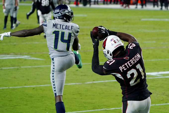 Arizona Cardinals cornerback Patrick Peterson (21) intercepts a pass intended for Seattle Seahawks wide receiver DK Metcalf (14) during the second half of an NFL football game, Sunday, Oct. 25, 2020, in Glendale, Ariz. (AP Photo/Rick Scuteri)