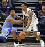 Northwestern guard Ryan Taylor, right, drives against Columbia guard CJ Davis during the first half of an NCAA college basketball game Sunday, Dec. 30, 2018, in Evanston, Ill. (AP Photo/Nam Y. Huh)