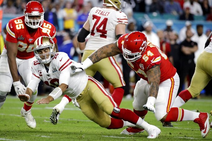 San Francisco 49ers quarterback Jimmy Garoppolo (10) is hit by Kansas City Chiefs' Mike Pennel (64) after throwing an interception during the first half of the NFL Super Bowl 54 football game Sunday, Feb. 2, 2020, in Miami Gardens, Fla. (AP Photo/Patrick Semansky)