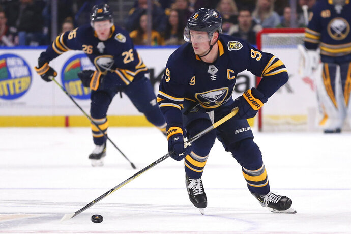 Buffalo Sabres forward Jack Eichel (9) skates with the puck during the first period of an NHL hockey game against the Columbus Blue Jackets, Saturday, Feb. 1, 2020, in Buffalo, N.Y. (AP Photo/Jeffrey T. Barnes)