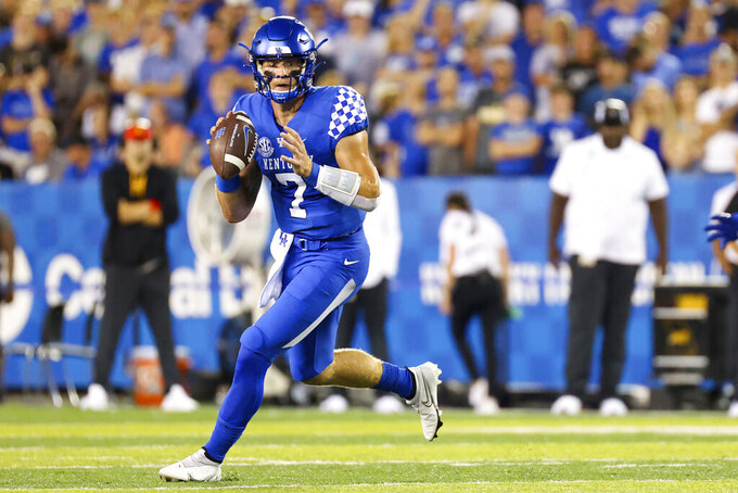 Kentucky quarterback Will Levis (7) looks for an open receiver during the first half of an NCAA college football game against Missouri in Lexington, Ky., Saturday, Sept. 11, 2021. (AP Photo/Michael Clubb)