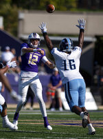 James Madison quarterback Cole Johnson (12) throws a pass over Maine defensive lineman Xavier Mitchell (16) during the first half of an NCAA college football game in Harrisonburg, Va., Saturday, Sep. 11, 2021. (Daniel Lin/Daily News-Record Via AP)