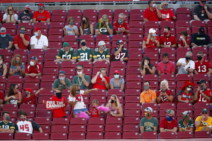 Fans social distance during an NFL football game between the Green Bay Packers and the Tampa Bay Buccaneers Sunday, Oct. 18, 2020, in Tampa, Fla. Anyone visiting Tampa's popular outdoor destinations for the Super Bowl will be required to wear a mask to help prevent the spread of the coronavirus. Tampa Mayor Jane Castor signed an executive order Wednesday, Jan. 27, 2021, saying masks must be worn outside while downtown, in neighborhoods around Raymond James Stadium — where the Super Bowl will be held — and in other tourist hotspots. (AP Photo/Jeff Haynes)