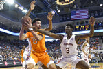 Tennessee forward Olivier Nkamhoua (21) looks for an open man over Auburn forward Danjel Purifoy (3) during the first half of an NCAA college basketball game Saturday, Feb. 22, 2020, in Auburn, Ala. (AP Photo/Julie Bennett)