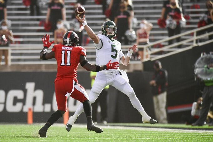 Baylor quarterback Charlie Brewer (5) throws under pressure from Texas Tech defensive back Eric Monroe (11) at an NCAA college football game in Lubbock, Texas, Saturday, Nov. 14, 2020. (AP Photo/Justin Rex)