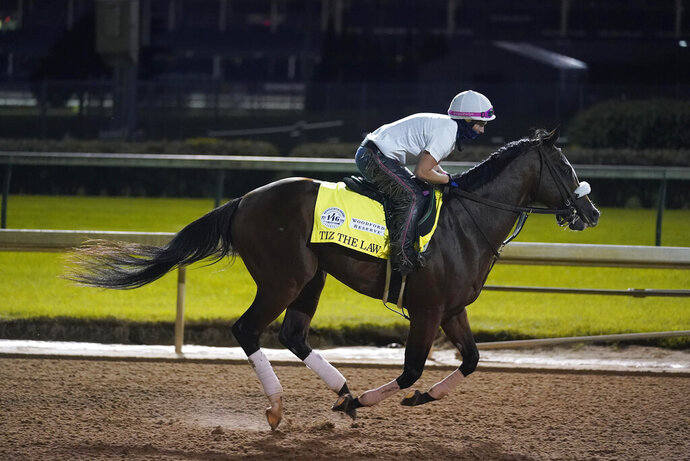 Kentucky Derby entry Tiz the Law runs during a workout at Churchill Downs, Friday, Sept. 4, 2020, in Louisville, Ky. The Kentucky Derby is scheduled for Saturday, Sept. 5th. (AP Photo/Darron Cummings)