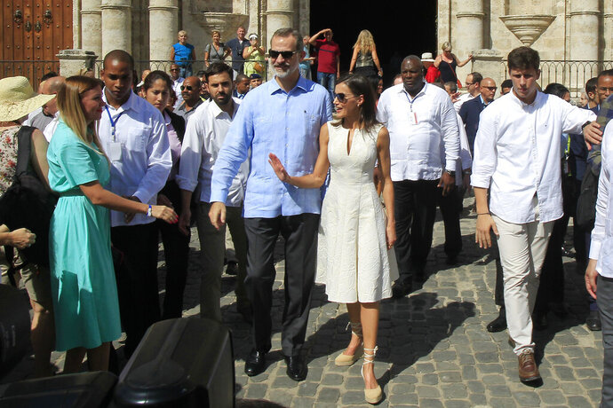 Spain's King Felipe VI and Queen Letizia walk in Old Havana, Cuba, Tuesday, Nov. 12, 2019. (Jorge Luis Baños/Pool Photo via AP)