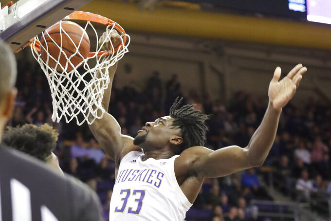 Washington's Isaiah Stewart dunks during the first half of the team's NCAA college basketball game against Stanford on Thursday, Feb. 20, 2020, in Seattle. (AP Photo/Elaine Thompson)