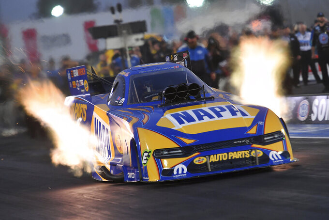 In this photo provided by the NHRA, Ron Capps drives in Funny Car qualifying at the NHRA Sonoma Nationals drag races Friday, July 23, 2021, in Sonoma, Calif. (Richard H Shute/Auto Imagery/NHRA via AP)