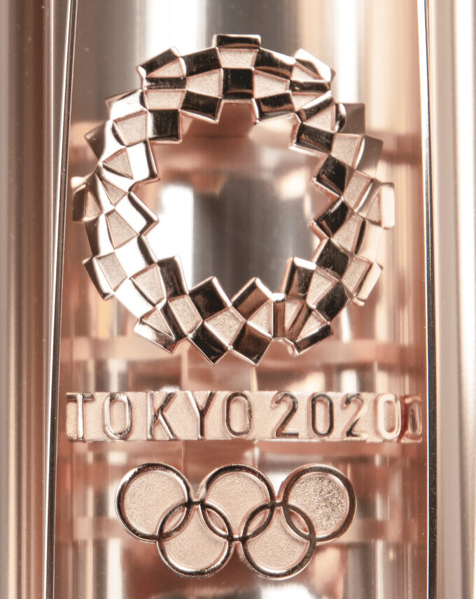 In this photo provided by RR Auction of Boston, an Olympic torch from the postponed Tokyo 2020 Olympic Games is shown. Olympic medals dating to 1896, relay torches from several eras, and other Olympic memorabilia are among the items being auctioned by RR Auction, just 10 days before the start of the Tokyo games. (Nikki Brickett/RR Auction via AP)