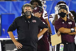 FILE- In this Saturday, Oct. 10, 2020, file photo, Mississippi State coach Mike Leach stands on the sideline during the second half of the team's NCAA college football game against Kentucky in Lexington, Ky. Mississippi State has managed a single victory, over winless Vanderbilt, in its last five games, averaging a mere 7.5 points in the losses. They face Georgia on Saturday night in Athens, Ga. (AP Photo/Bryan Woolston, File)