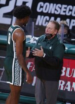 Michigan State coach Tom Izzo, right, talks with Aaron Henry during the first second of an NCAA college basketball game against Wisconsin, Friday, Dec. 25, 2020, in East Lansing, Mich. Wisconsin won 85-76. (AP Photo/Al Goldis)