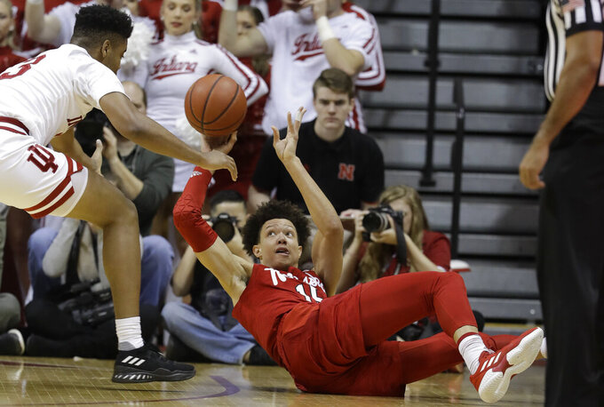 Nebraska's Isaiah Roby (15) makes a pass while be defended by Indiana's Juwan Morgan (13) during the first half of an NCAA basketball game, Monday, Jan. 14, 2019, in Bloomington, Ind. (AP Photo/Darron Cummings)