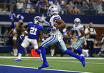 Dallas Cowboys wide receiver Randall Cobb (18) scores a touchdown after catching a pass as New York Giants free safety Jabrill Peppers (21) looks on in the second half of a NFL football game in Arlington, Texas, Sunday, Sept. 8, 2019. (AP Photo/Ron Jenkins)