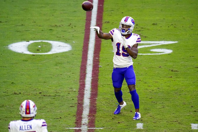Buffalo Bills wide receiver Isaiah McKenzie (19) throws a touchdown pass to quarterback Josh Allen during the first half of an NFL football game against the Arizona Cardinals, Sunday, Nov. 15, 2020, in Glendale, Ariz. (AP Photo/Ross D. Franklin)