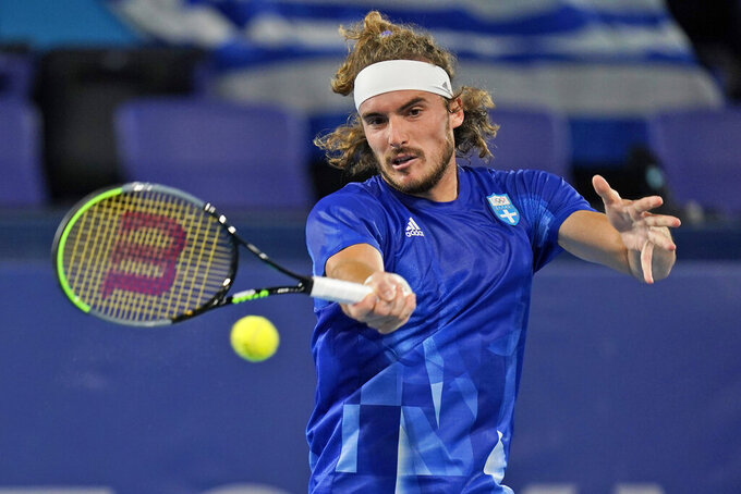 Stefanos Tsitsipas, of Greece, plays Frances Tiafoe, of the United States, during the second round of the tennis competition at the 2020 Summer Olympics, Tuesday, July 27, 2021, in Tokyo, Japan. (AP Photo/Seth Wenig)