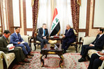 A photo released by the Iraqi Prime Minister Media Office, shows Iraqi acting Prime Minister Adil Abdul-Mahdi, center right, meeting with U.S. Ambassador to Iraq Matthew Tueller at the prime minister's office, in Baghdad, Iraq, Monday, Jan. 6, 2020. (Iraqi Prime Minister Media Office, via AP)