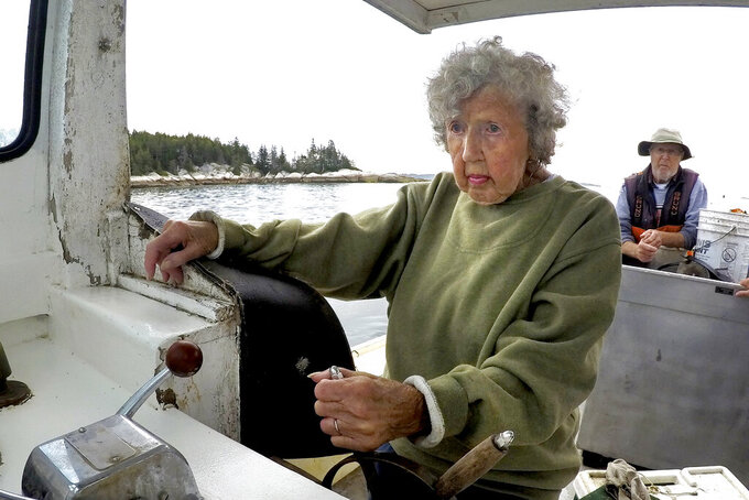 Virginia Oliver, age 101, pilots her son Max Oliver's boat, Tuesday, Aug. 31, 2021, off Rockland, Maine.  Oliver is the oldest lobster fisher in the state and possibly the oldest one in the world.  (AP Photo/Robert F. Bukaty)