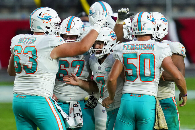 Miami Dolphins kicker Jason Sanders (7) celebrates his field goal with teammates during the second half of an NFL football game against the Arizona Cardinals, Sunday, Nov. 8, 2020, in Glendale, Ariz. (AP Photo/Ross D. Franklin)