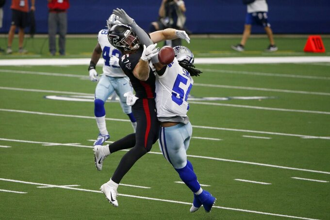 Atlanta Falcons tight end Hayden Hurst (81) is unable to catch a pass under pressure from Dallas Cowboys middle linebacker Jaylon Smith (54) in the first half of an NFL football game in Arlington, Texas, Sunday, Sept. 20, 2020. (AP Photo/Michael Ainsworth)