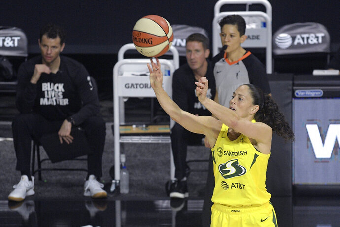 FILE - In this Saturday, July 25, 2020, file photo, Seattle Storm guard Sue Bird shoots during the first half of a WNBA basketball game against the New York Liberty in Bradenton, Fla. Bird will be sidelined for a bit as she recovers from a bone bruise in her left knee. Seattle's star guard felt the injury during the team's win over Minnesota last week. (AP Photo/Phelan M. Ebenhack, File)