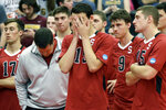 FILE - In this May 3, 2014, file photo, Stanford men's volleyball head coach John Kosty, second from left, looks down as players react after a 3-1 loss to Loyola in the NCAA men's college volleyball championship at Gentile Arena in Chicago. Stanford announced Wednesday, July 8, 2020,  that it is dropping 11 sports amid financial difficulties caused by the coronavirus pandemic. The school will discontinue men's and women's fencing, field hockey, lightweight rowing, men's rowing, co-ed and women's sailing, squash, synchronized swimming, men's volleyball and wrestling after the 2020-21 academic year. Stanford also is eliminating 20 support staff positions. (AP Photo/Nam Y. Huh, File)