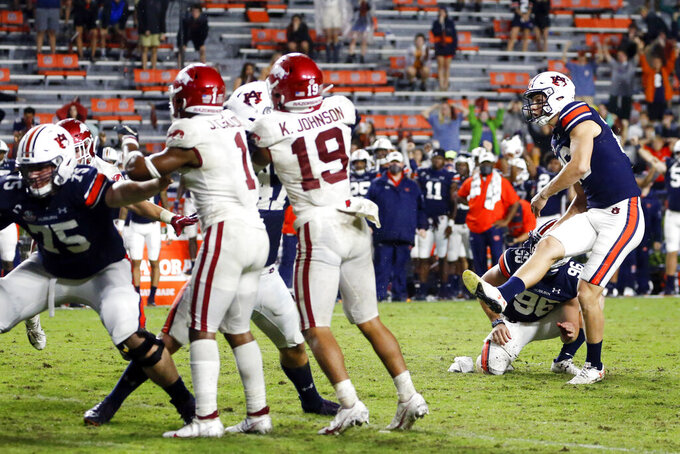 Auburn's Anders Carlson (26) kicks the go-ahead field goal against Arkansas during the second half of an NCAA college football game Saturday, Oct. 10, 2020, in Auburn, Ala. Auburn won 30-28. (AP Photo/Butch Dill)