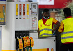 Closed fuel pumps at a petrol station in London, Tuesday, Sept. 28, 2021. Long lines of vehicles have formed at many gas stations around Britain since Friday, causing spillover traffic jams on busy roads. (AP Photo/Frank Augstein)