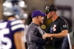 Kansas State head coach Chris Klieman, left, and Southern Illinois head coach Nick Hill greet each other after their NCAA college football game, Saturday, Sept. 11, 2021, in Manhattan, Kan. Kansas State won 31-23 (AP Photo/Charlie Riedel)