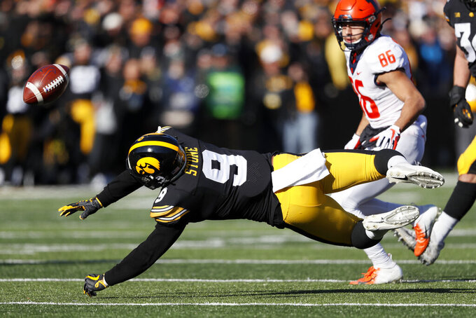 Iowa defensive back Geno Stone breaks up a pass intended for Illinois wide receiver Donny Navarro (86) during the first half of an NCAA college football game, Saturday, Nov. 23, 2019, in Iowa City, Iowa. (AP Photo/Charlie Neibergall)