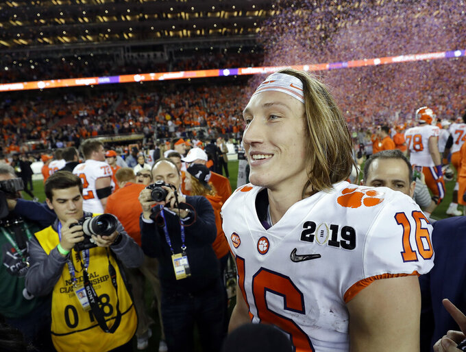 FILE - In this Jan. 7, 2019, file photo, Clemson's Trevor Lawrence celebrates after the NCAA college football playoff championship game against Alabama, in Santa Clara, Calif. For the first time, the defending national champion Tigers are No. 1 in The Associated Press preseason Top 25 presented by Regions Bank, Monday, Aug. 19, 2019. Clemson won its second national title in three seasons behind freshman quarterback Trevor Lawrence to claim equal standing with Alabama at the top of the sport. (AP Photo/David J. Phillip, File)