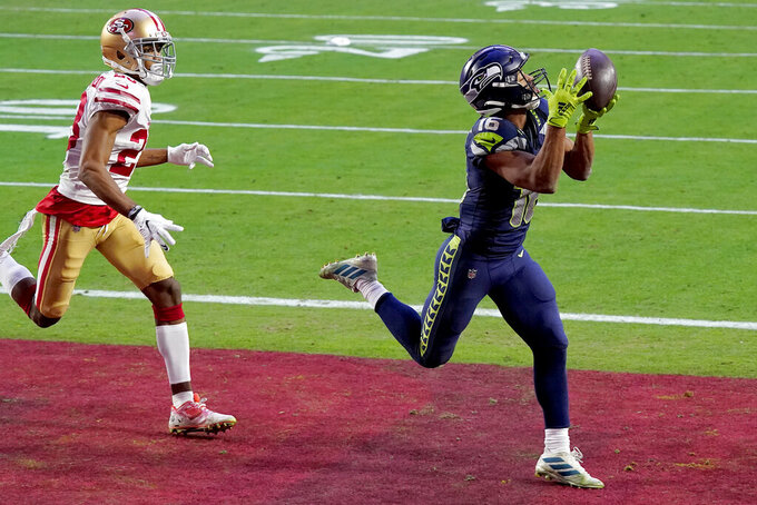 Seattle Seahawks wide receiver Tyler Lockett (16) pulls in a touchdown as San Francisco 49ers cornerback Ahkello Witherspoon (23) defends during the second half of an NFL football game, Sunday, Jan. 3, 2021, in Glendale, Ariz. (AP Photo/Ross D. Franklin)