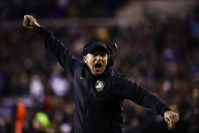 Army head coach Jeff Monken cheers during the second half an NCAA college football game against the Navy, Saturday, Dec. 8, 2018, in Philadelphia. Army won 17 -10. (AP Photo/Matt Rourke)