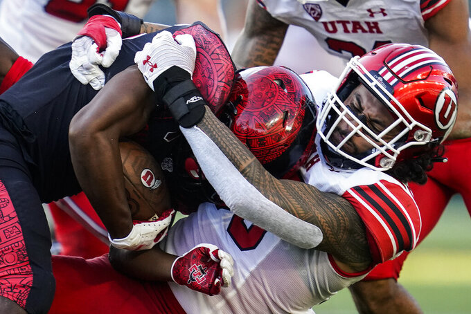 San Diego State running back Jordan Byrd, left, is tackled by Utah linebacker Andrew Mata'afa (55) during the first half of an NCAA college football game Saturday, Sept. 18, 2021, in Carson, Calif. (AP Photo/Ashley Landis)