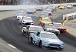 Kevin Harvick races with the pack during a NASCAR Cup Series auto race Sunday, July 22, 2018, at New Hampshire Motor Speedway in Loudon, N.H. (AP Photo/Mary Schwalm)